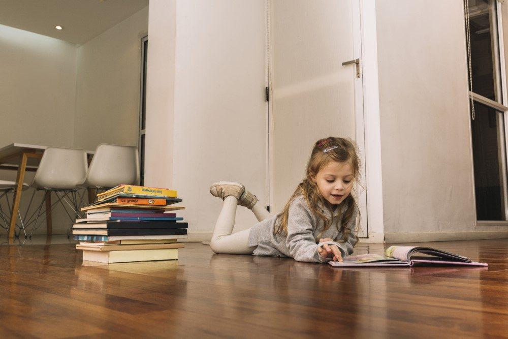 Girl Child on Hardwood Floor